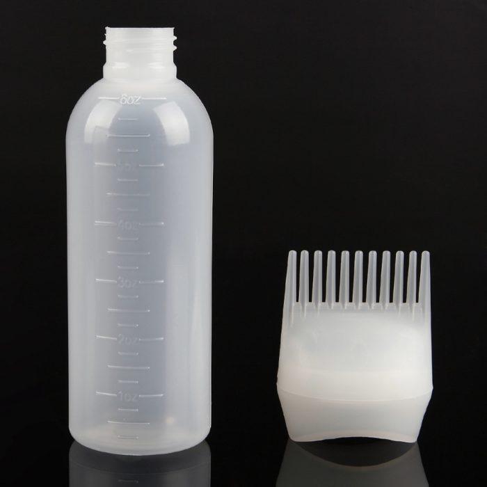בקבוק שמפו משולב עם מסרק